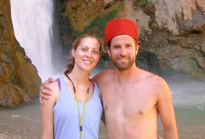 Eva Amurri Martino poses with husband Kyle in front of a waterfall while rafting in the Grand Canyon