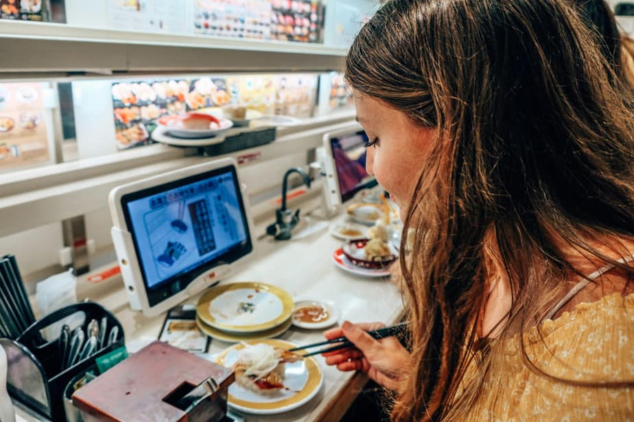 Girl eating sushi in Shibuya Tokyo