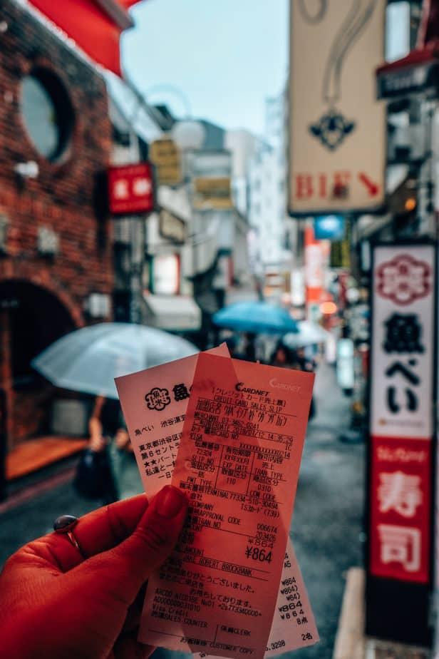 Receipts from kaiten sushi in Tokyo