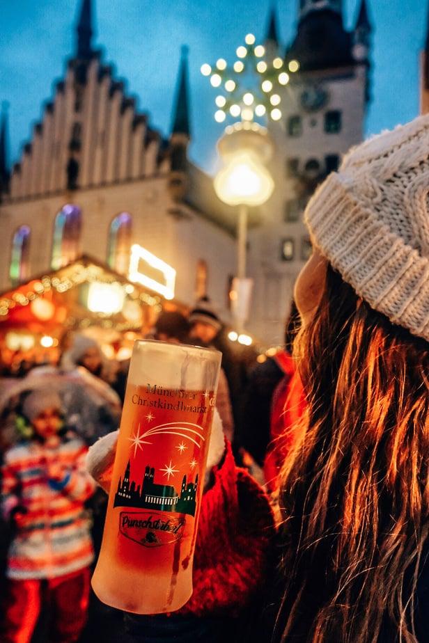 girl drinking kinderpunch in Munich Germany