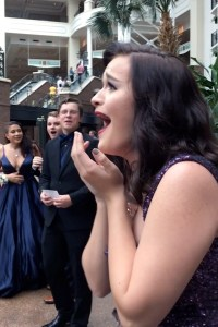 Marybel Lindsey reacts after realizing her date is in the background of her prom photos