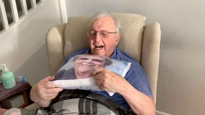 Robert holds his memory pillow