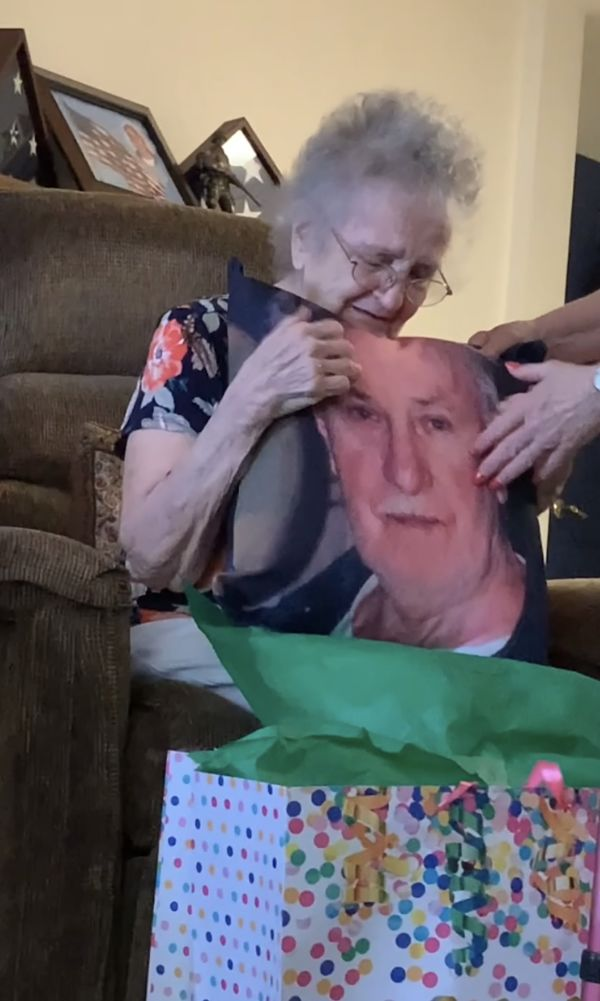 Grandmother surprised with memory pillow