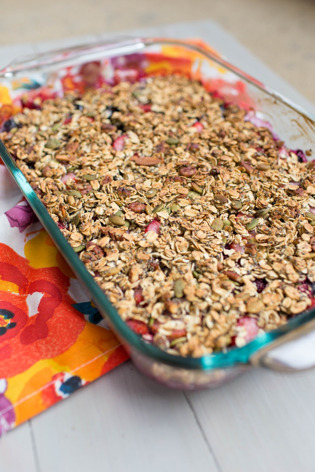 This summer berry crisp is the perfect dessert or breakfast treat! Gluten and dairy free! | read more at happilythehicks.com