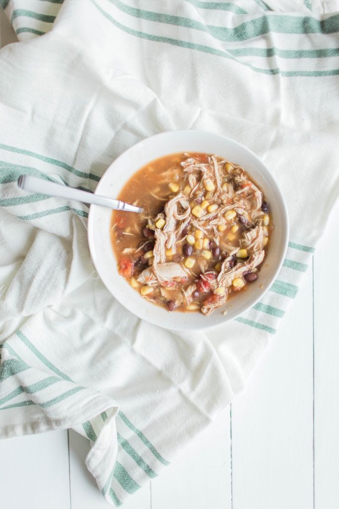 This shredded chicken taco soup is THE perfect meal to make for a cold winter's night! | read more at happilythehicks.com
