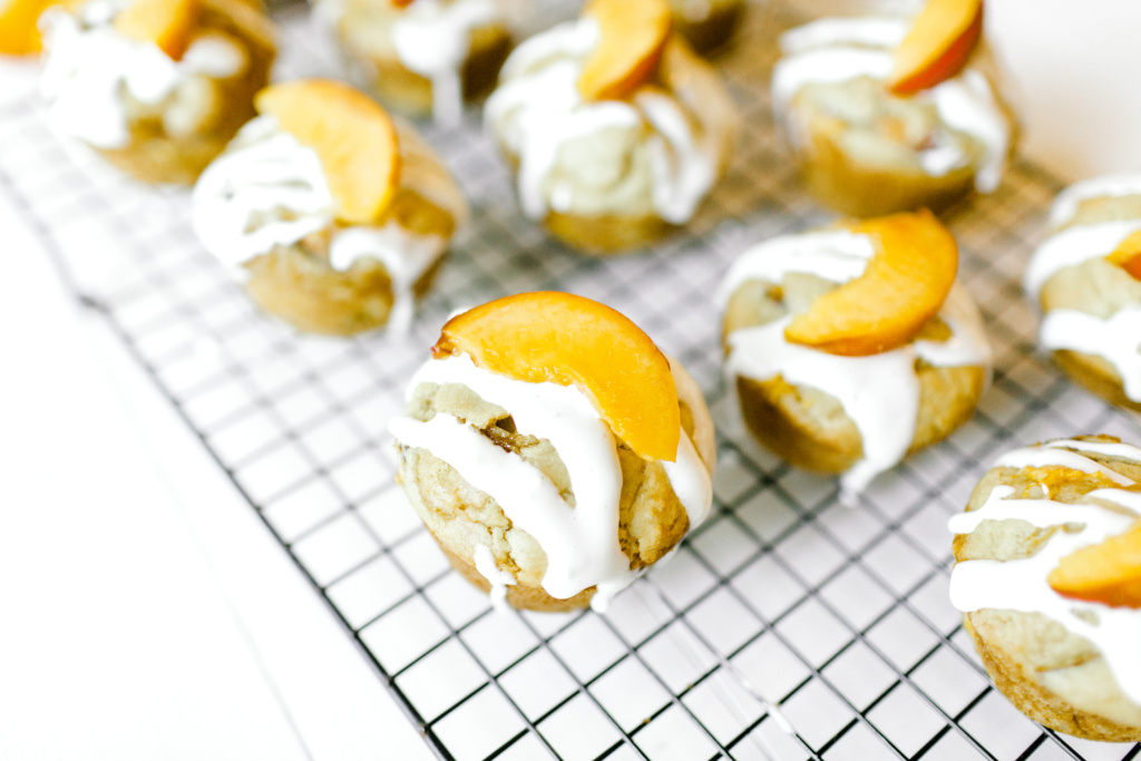 Peach Muffins with Cream Cheese Drizzle | read more at happilythehicks.com