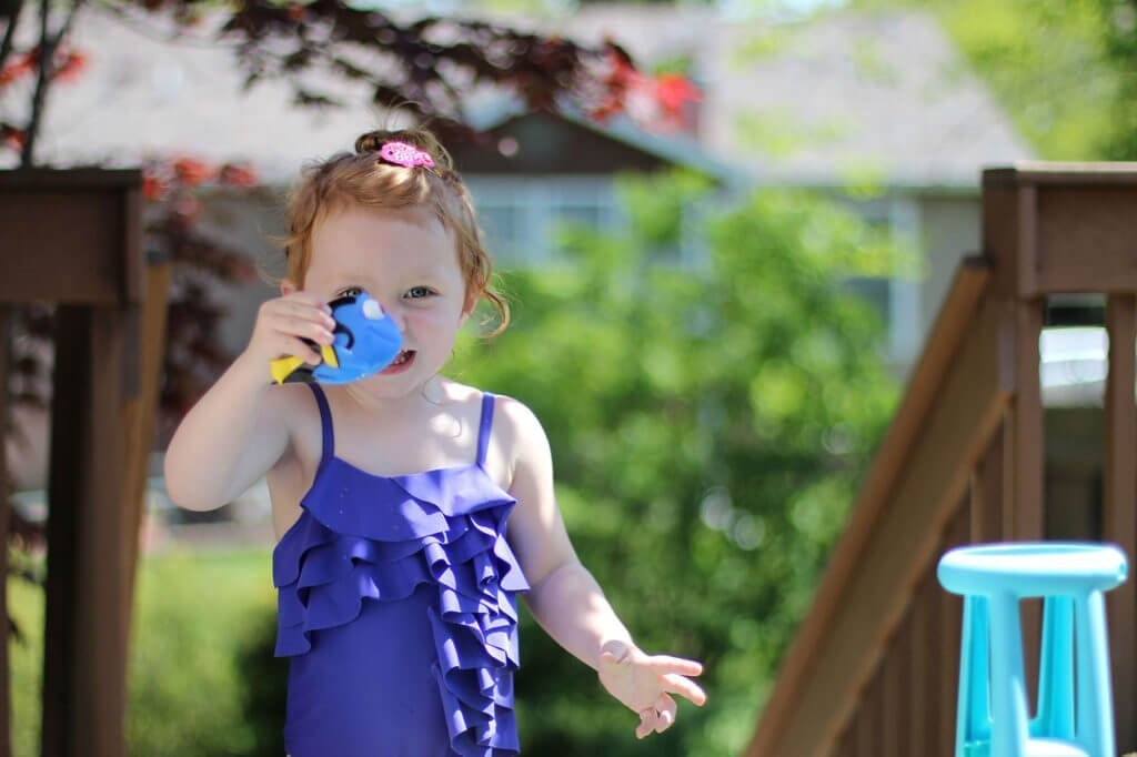 Blaire playing in water table