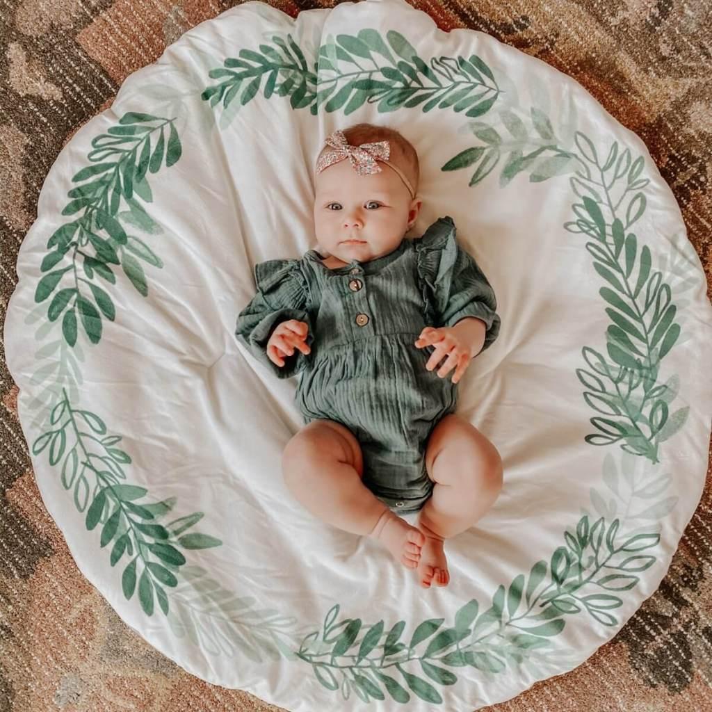 baby Sloane wearing bubble romper