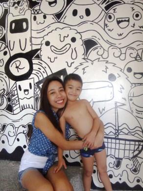 Love the kid. Love the wall.