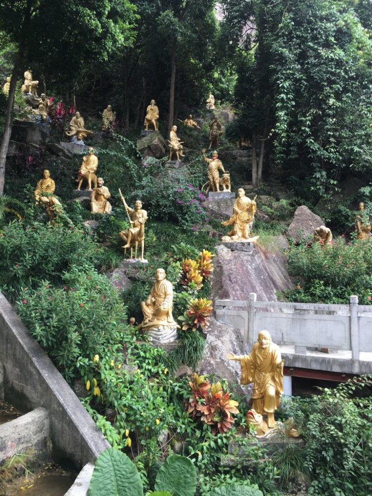 More Buddhas on the rocks near the hill..