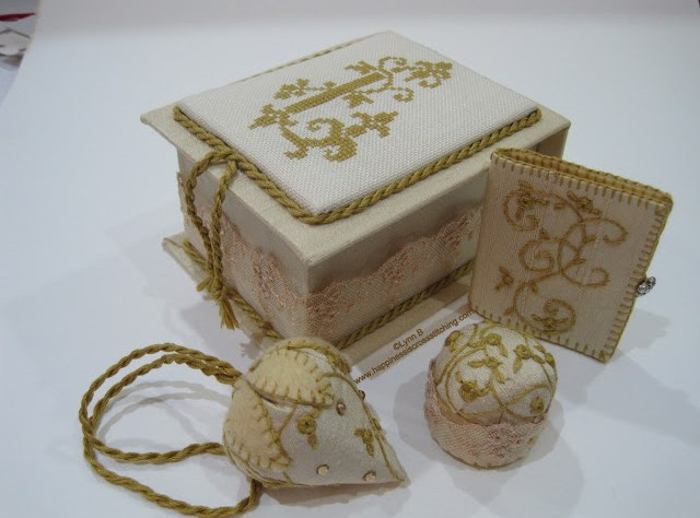 Cross stitch covered box, stitched using dmc gold coloured thread with matching needlebook, scissor fob and pin cushion