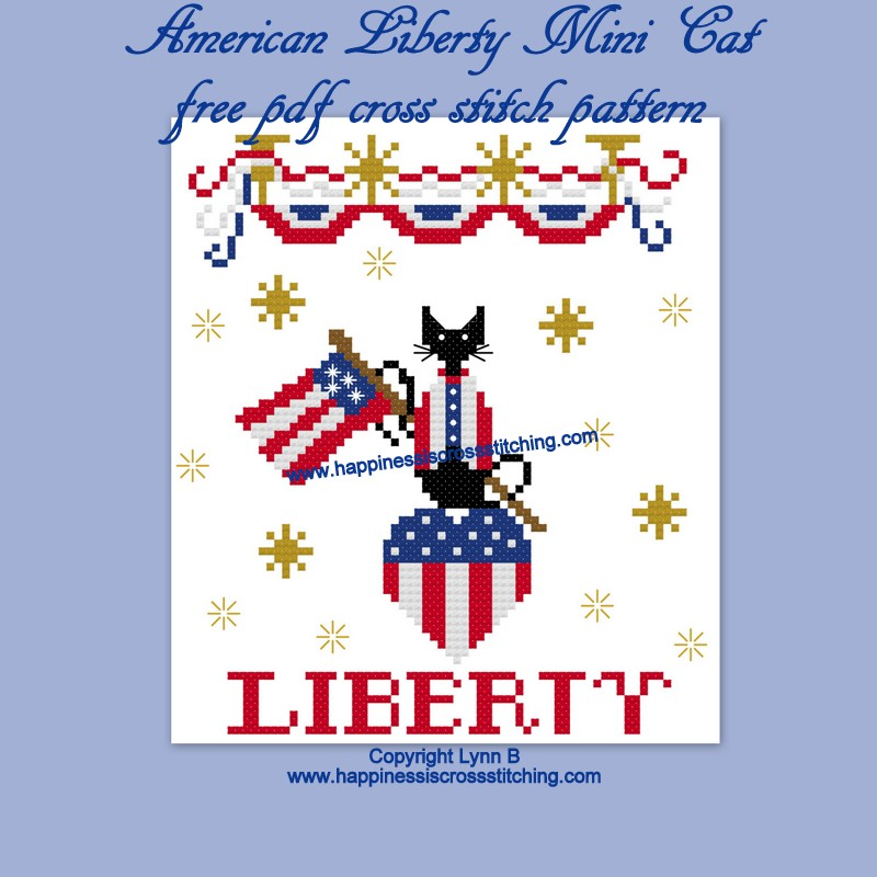 Free cross stitch pattern featuring a Little Black cat holding the American flag celebrating American Independance Day