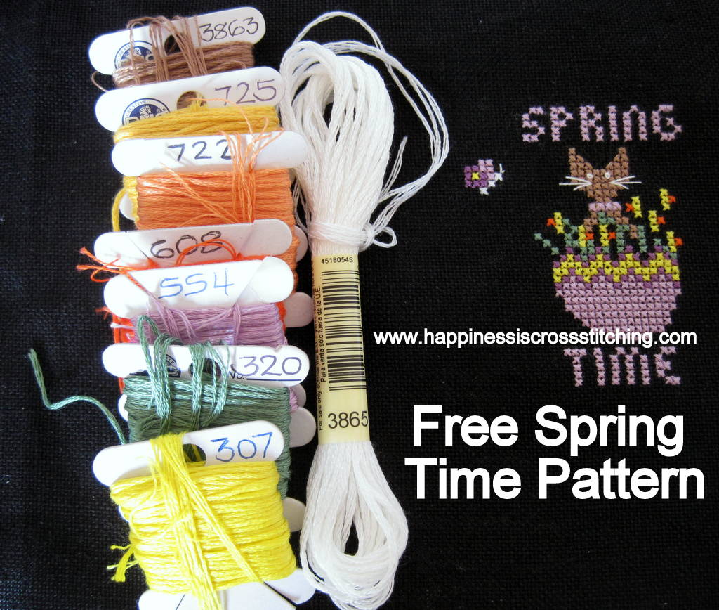 Free Spring Time cross stitch pattern featuring a black cat inside an Easter Egg with daffodils