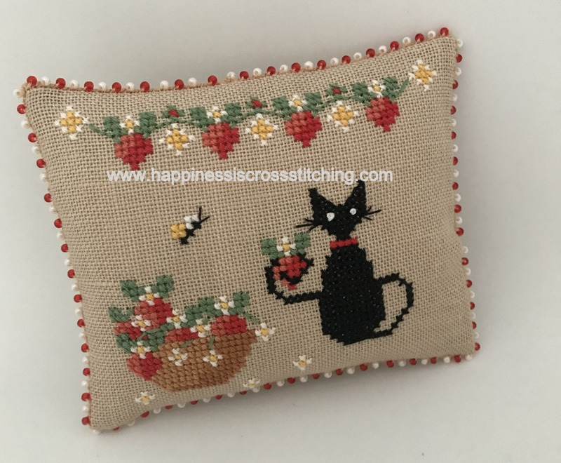 Strawberry mini cat beaded pillow. Black cat with a bowl of strawberries.