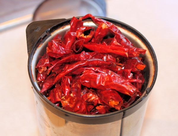 dried peppers in spice grinder