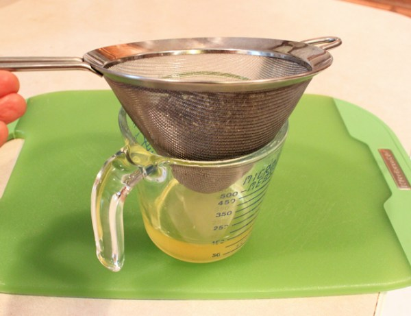 straining oil using fine mesh strainer