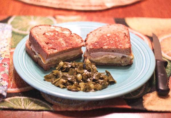 Turkey Reuben sandwich with braised kale