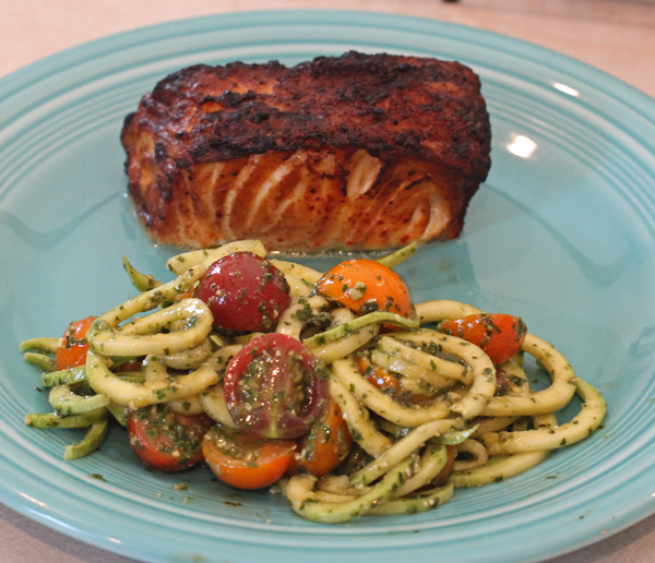 zoodles and pesto with cherry tomatoes