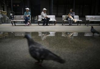 elderly-people-take-a-break-on-bench-seats-at-tokyo-s-sugamo-district-an-area-popular-among-the-japanese-elderly-in-tokyo