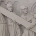 Simon of Cyrene helps Jesus bear the burden of the Cross: marble carving from Germany