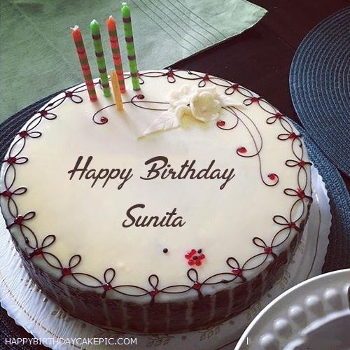 Candles Decorated Happy Birthday Cake For Sunita