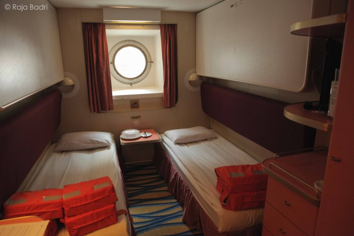This is our room. It is the Oceanview Stateroom with porthole.