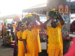 Devotees carrying pots of milk to the Batu Caves for Thaipusam