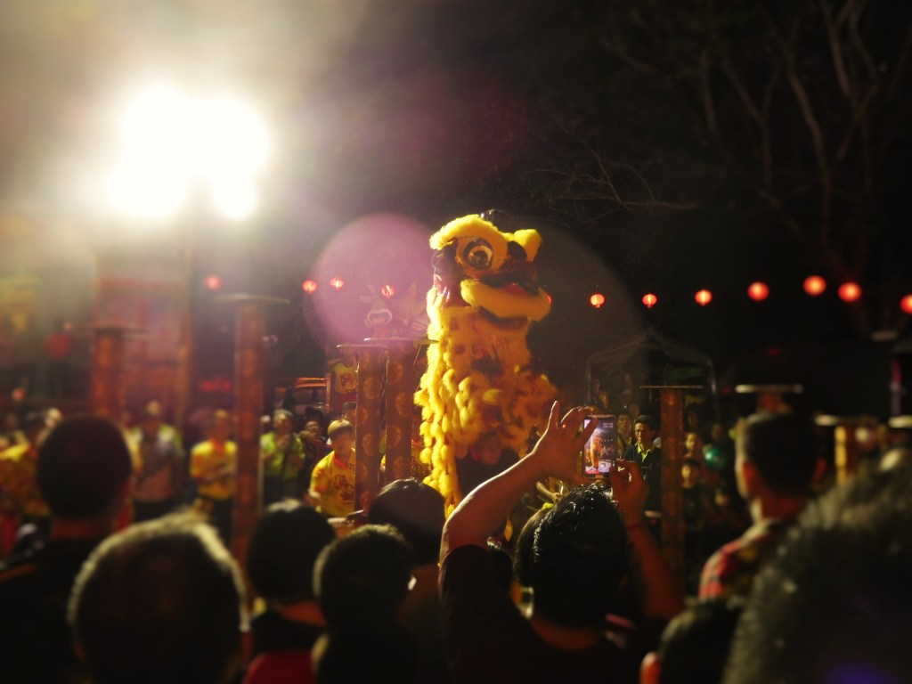A lion dance outside the Snake Temple