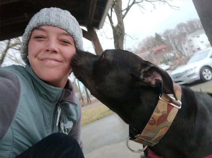 runner getting dog kisses