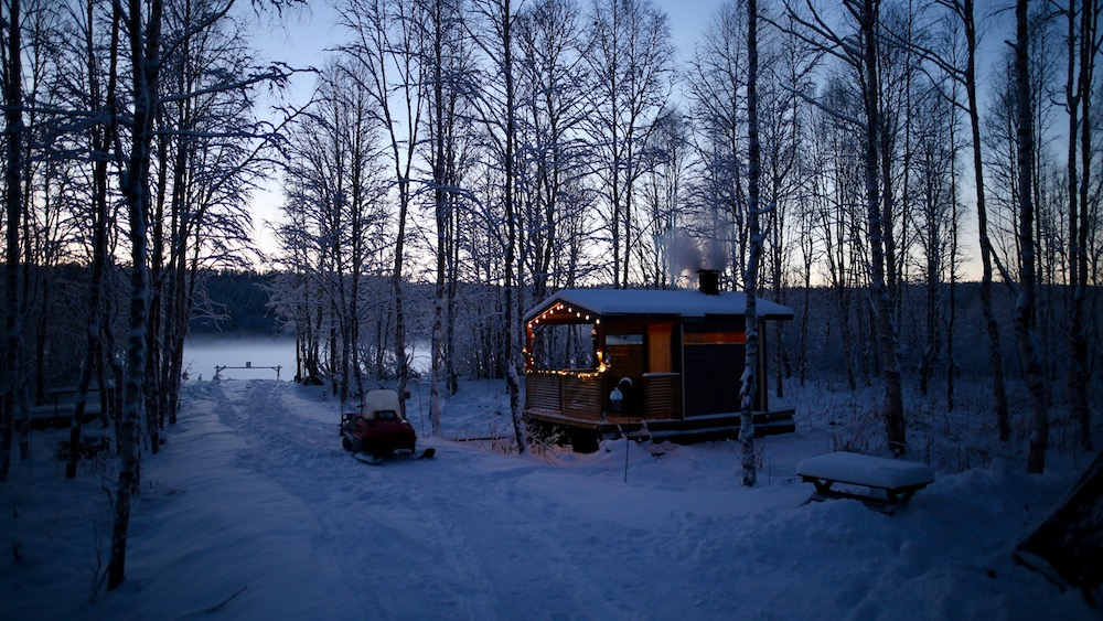 Happy-Fox-Arctic-Extreme-Ice-Swimming-and-Sauna-river-shore-p
