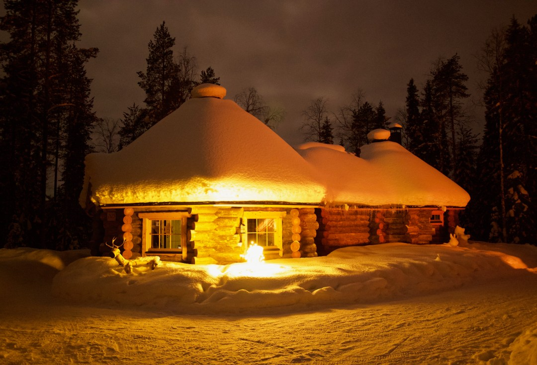 Happy-Fox-Finnish-Christmas-with-Santa-Claus-fox-cottage-at-night
