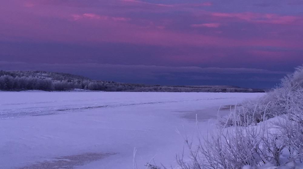 Happy-Fox-Trip-Along-the-Ounasjoki-River-on-Snowmobile-pulled-Sled-lilac-sky-and-ounasjoki-river