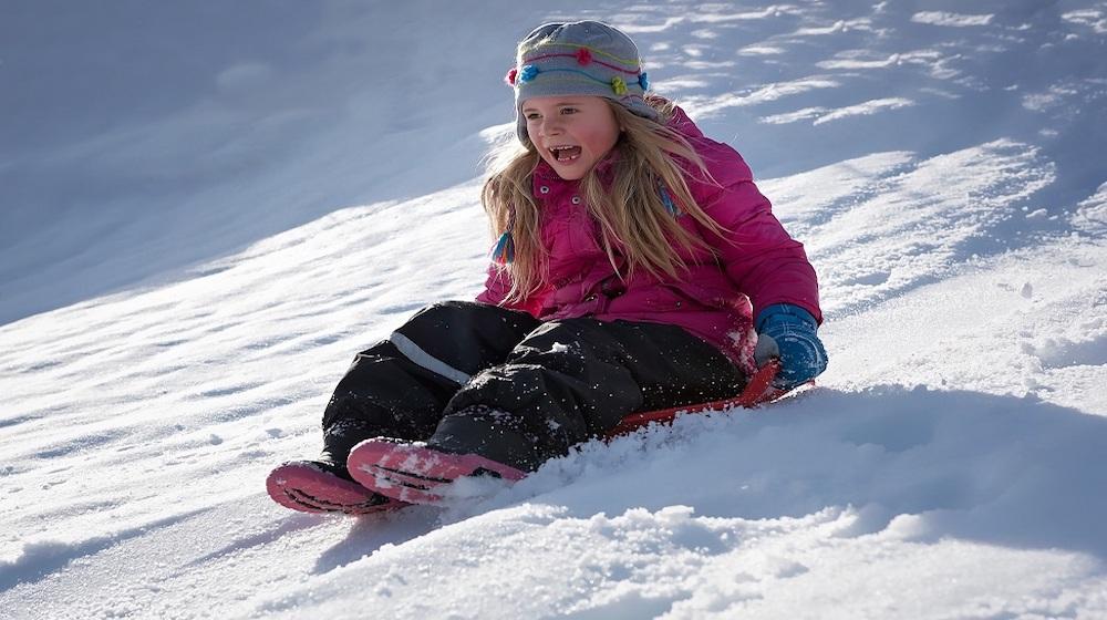 Happy-Fox-Winter-Fun-girl-sliding-on-snow
