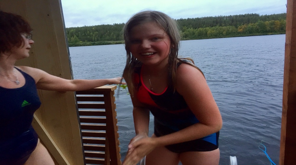 Happy-Fox-Floating-sauna-and-swimming-girl-on-terrance