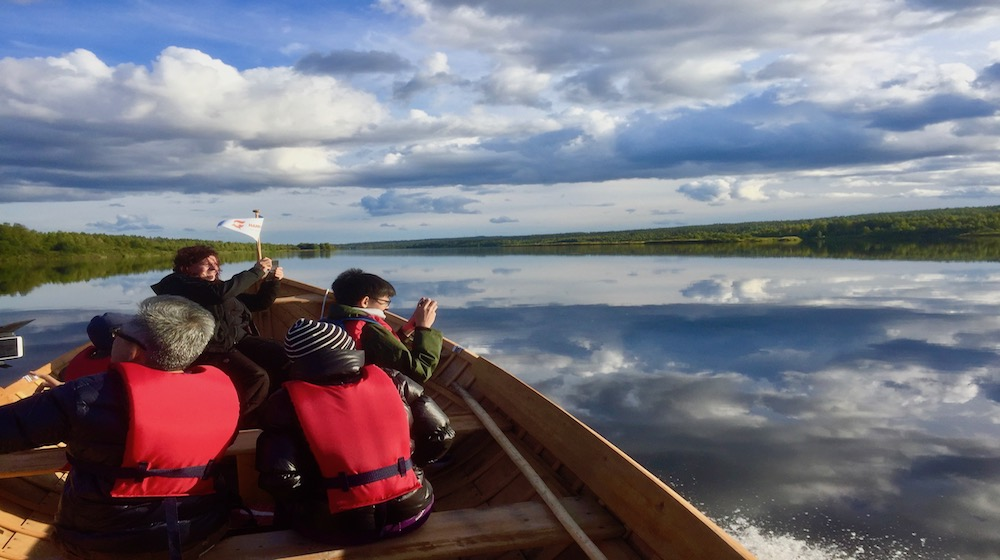 Happy-Fox-Arctic-Boat-Trip-to-the-Ounasjoki-River-summer-clouds-on-ounasjoki-river