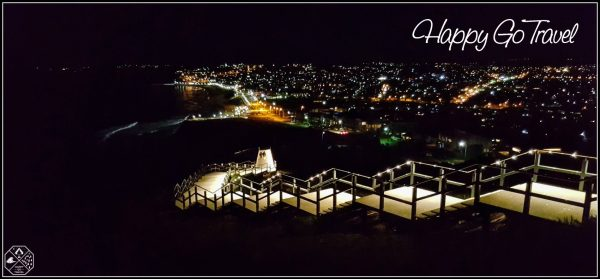 ANZAC Memorial Walk Newcastle at night with city lights