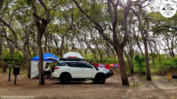 Toyota Fortuner parked in front of Black Series camper trailer setup at Fraser Island cathedrals   cost to go to fraser island