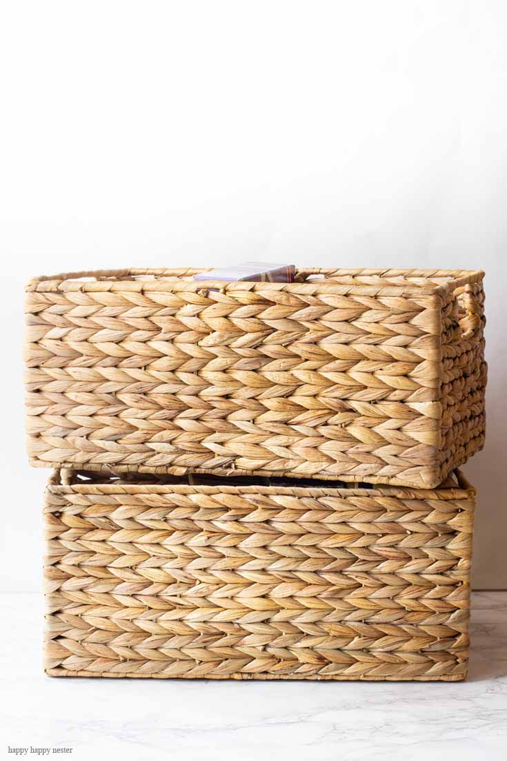 I love these water hyacinth baskets for organizing. Use baskets, clear containers, and stacking boxes to get your kitchen in order. #organizing #kitchen