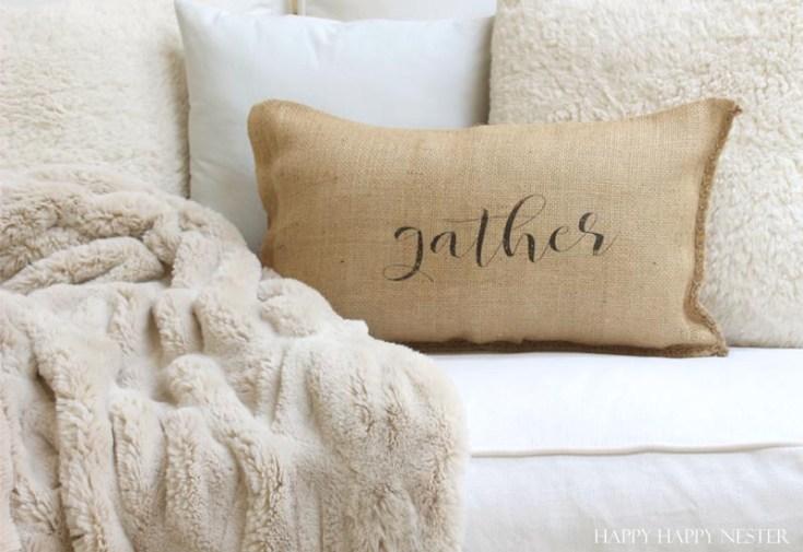 a burlap pillow that says gather