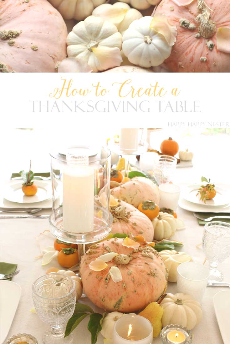 pink and white pumpkins on a decorated thanksgiving table
