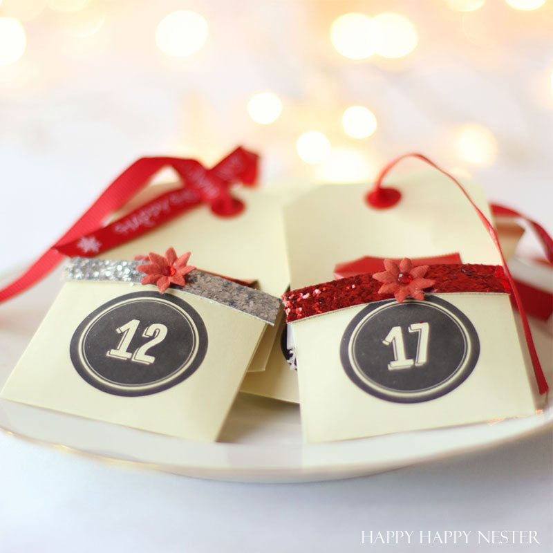 DIY Advent Tree uses your own Christmas tree. Place cute envelopes with numbers and fill with treats. This is the easiest advent tree you'll ever create!
