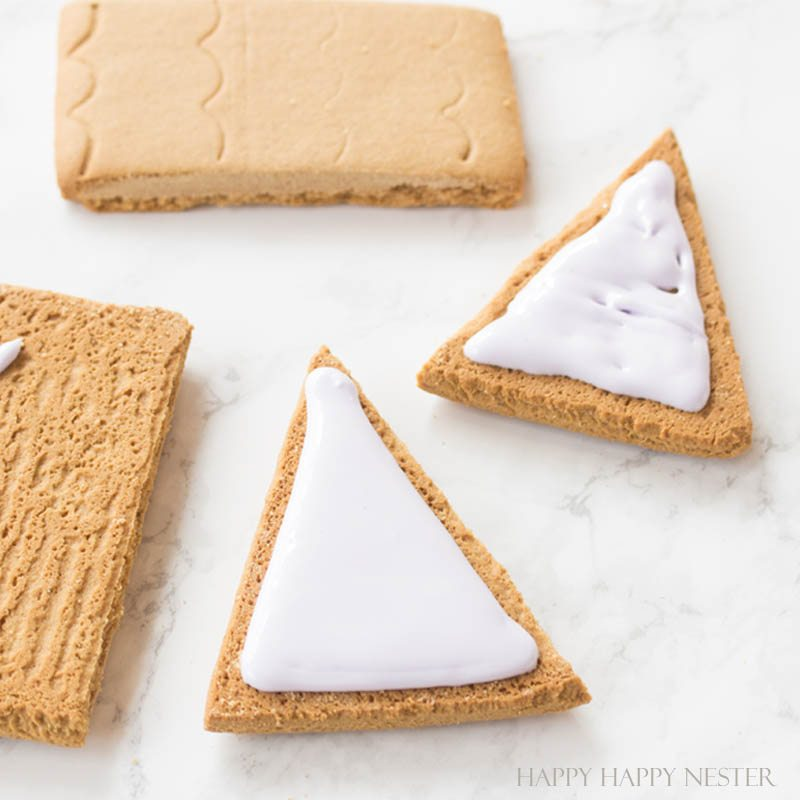Need some gingerbread house ideas? This fun Valentine's Day Craft is so adorable. Make one or a few to create a village with this mini-gingerbread house kit.   Gingerbread House Kits   Perfect Icing   Gingerbread Tutorial   How to put together a gingerbread house   Gingerbread house themes   crafts   diy