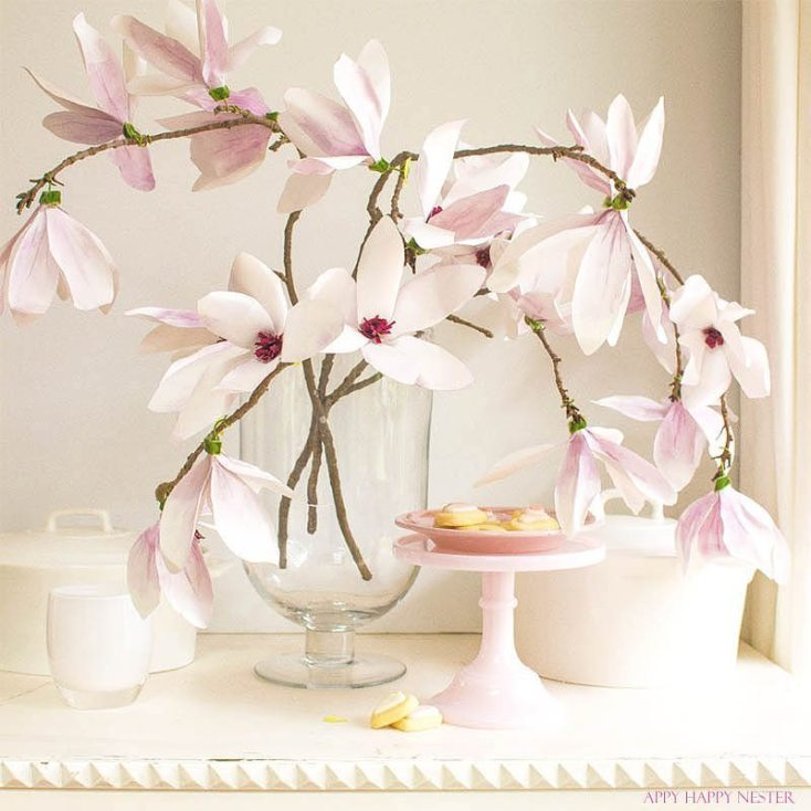 These magnolia flowers look so real. This paper flower tutorial you won't want to miss. I made this flower out of watercolor flower petals and added them to a tree branch, and you have lifelike flowers that you can make from paper. #DIY | #paperflowers | #crafts | #fauxflowers