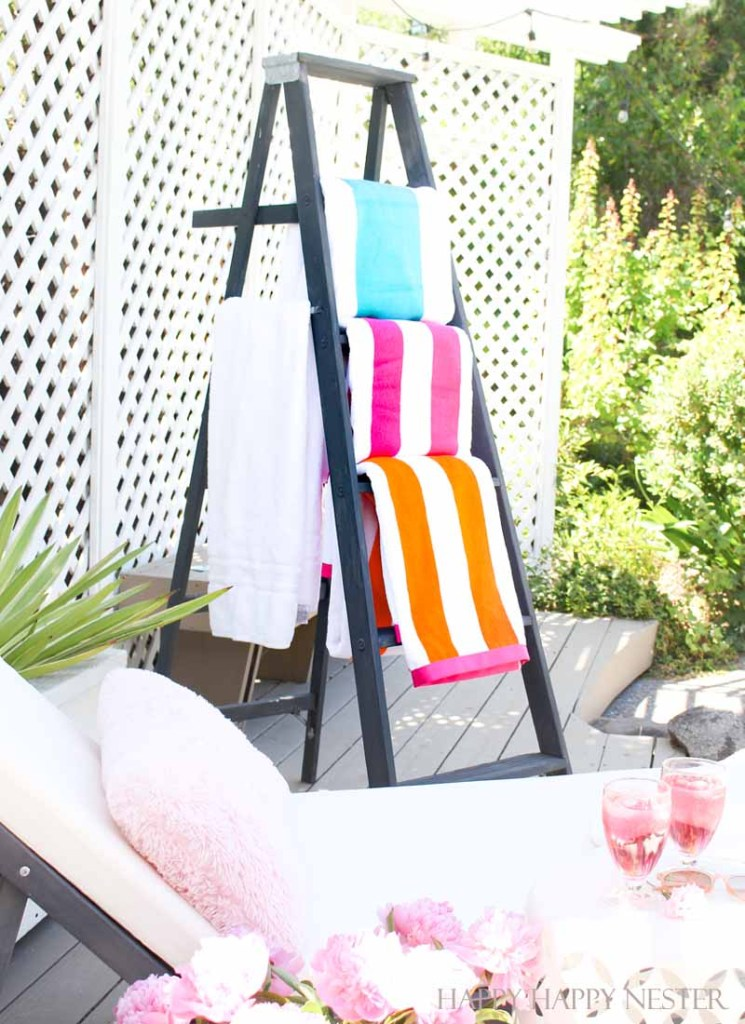 black ladder with pool towels
