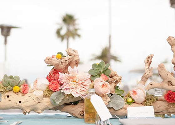 Succulent and driftwood decor for a wedding reception table