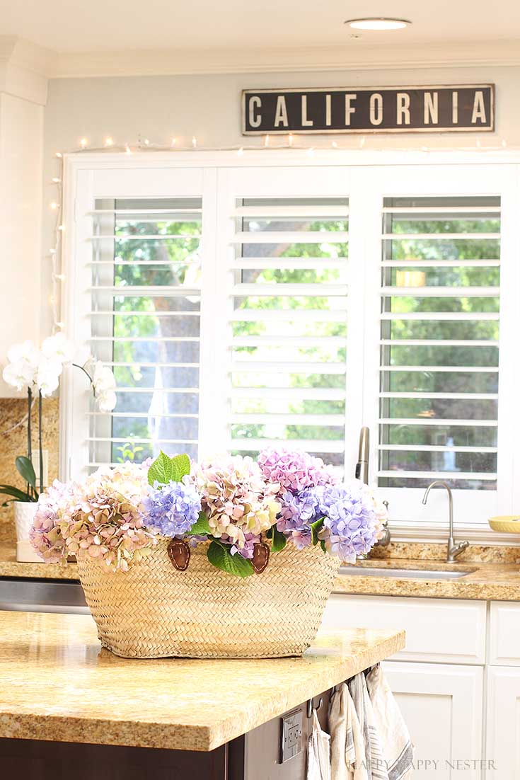 basket full of flowers on a kitchen island