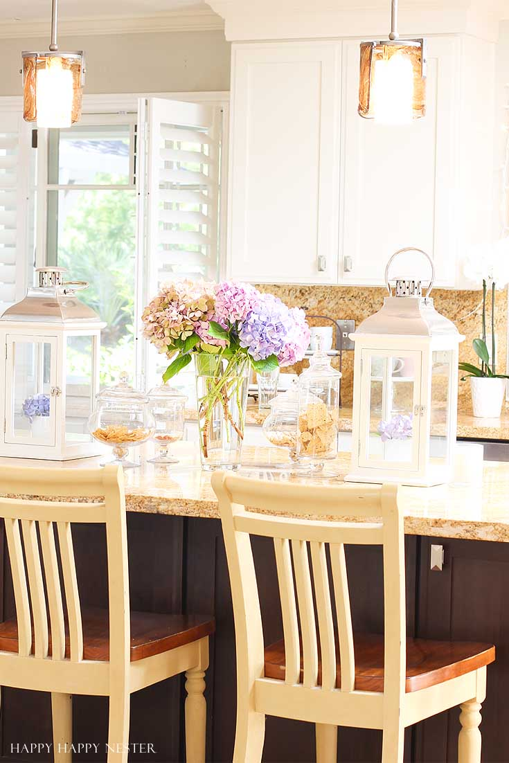yellow kitchen island with flowers