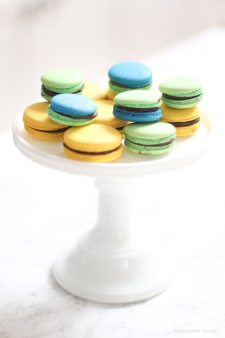 macaron cookies on a white cake stand