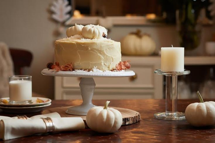 white cake on white cake stand on table