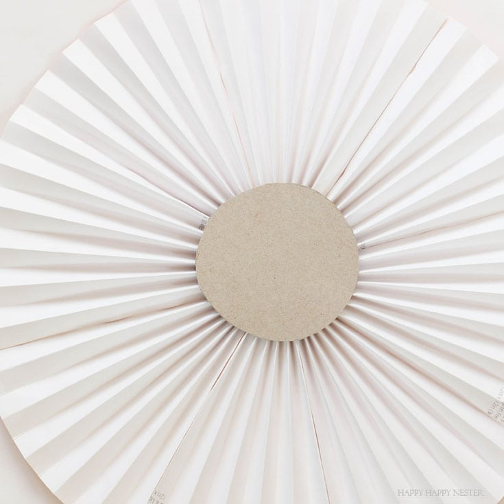 paper rosette with cardboard circle in the middle